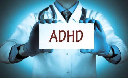 inattention: Doctor keeps a card with the name of the diagnosis – ADHD. Selective focus. Medical concept.