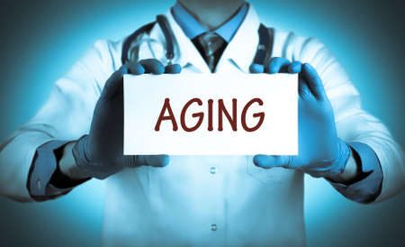decrepitude: Doctor keeps a card with the name of the diagnosis � aging. Selective focus. Medical concept.