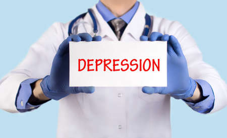keeps: Doctor keeps a card with the name of the diagnosis � depression. Selective focus. Medical concept.