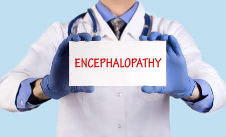 encephalopathy: Doctor keeps a card with the name of the diagnosis � encephalopathy. Selective focus. Medical concept. Stock Photo