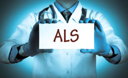 als: Doctor keeps a card with the name of the diagnosis � als. Selective focus. Medical concept.