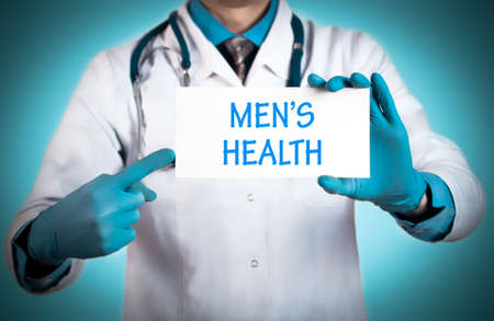 Doctor keeps a card with the name of the diagnosis – mens health. Selective focus. Medical concept.