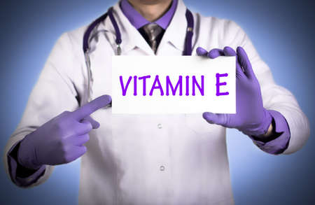 keeps: Doctor keeps a card with the name of the Vitamin E. Selective focus. Medical concept.
