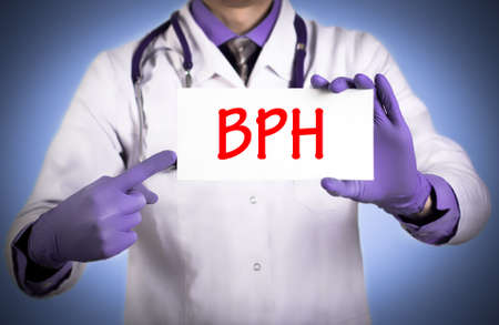 benign: Doctor keeps a card with the name of the diagnosis ? bph. Selective focus. Medical concept.