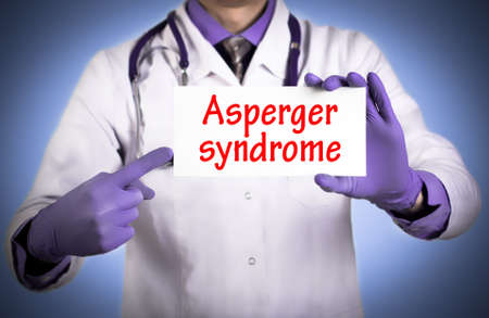 asperger syndrome: Doctor keeps a card with the name of the diagnosis � asperger syndrome. Selective focus. Medical concept.