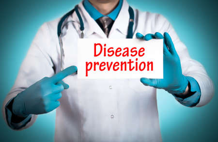 keeps: Doctor keeps a card with the name of the diagnosis � disease prevention. Selective focus. Medical concept. Stock Photo