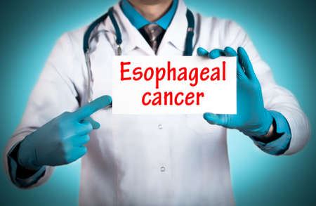 esophageal: Doctor keeps a card with the name of the diagnosis � esophageal cancer. Selective focus. Medical concept.