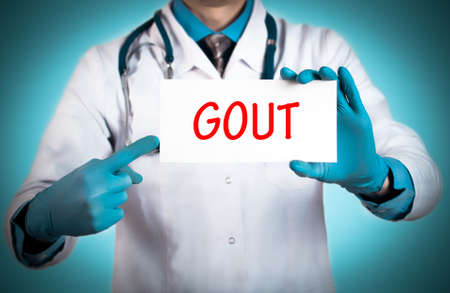 gout: Doctor keeps a card with the name of the diagnosis � gout. Selective focus. Medical concept. Stock Photo