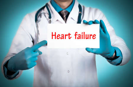 heart failure: Doctor keeps a card with the name of the diagnosis � heart failure. Selective focus. Medical concept.