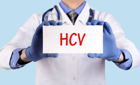 polymerase: Doctor keeps a card with the name of the diagnosis � hcv. Selective focus. Medical concept.