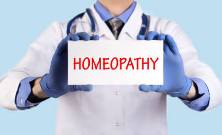 diagnosed: Doctor keeps a card with the name of the diagnosis – homeopathy. Selective focus. Medical concept.
