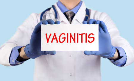 sexual intercourse: Doctor keeps a card with the name of the diagnosis � vaginitis. Selective focus. Medical concept. Stock Photo