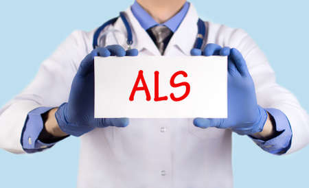 keeps: Doctor keeps a card with the name of the diagnosis – als. Selective focus. Medical concept.