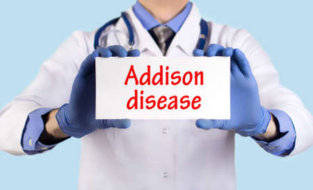 keeps: Doctor keeps a card with the name of the diagnosis � addison disease. Selective focus. Medical concept.