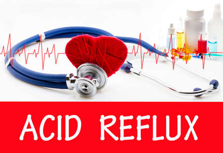 acid reflux: The diagnosis of acid reflux. Phonendoscope and vaccine with drugs. Medical concept.
