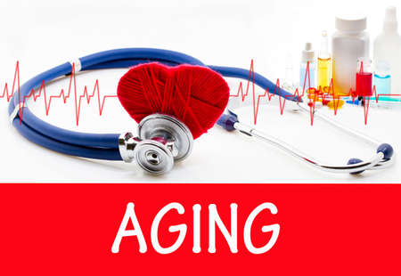 The diagnosis of aging. Phonendoscope and vaccine with drugs. Medical concept.