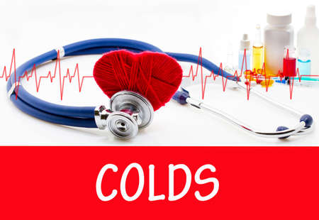 colds: The diagnosis of colds. Phonendoscope and vaccine with drugs. Medical concept.