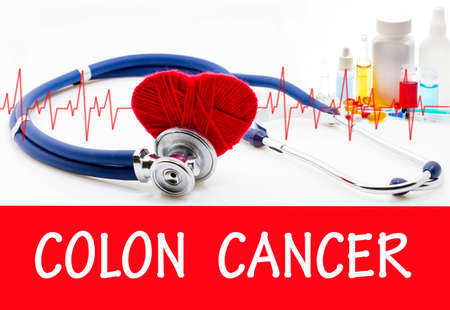 colon cancer: The diagnosis of colon cancer. Phonendoscope and vaccine with drugs. Medical concept. Stock Photo