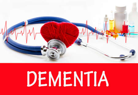 dementia: The diagnosis of dementia. Phonendoscope and vaccine with drugs. Medical concept.