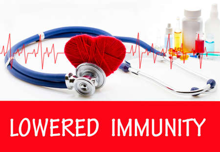 The diagnosis of lowered immunity. Phonendoscope and vaccine with drugs. Medical concept.