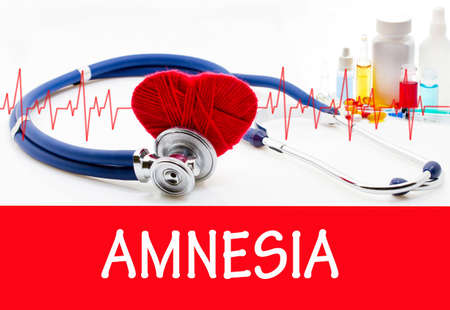 amnesia: The diagnosis of amnesia. Phonendoscope and vaccine with drugs. Medical concept. Stock Photo