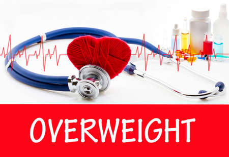potbelly: The diagnosis of overweight. Phonendoscope and vaccine with drugs. Medical concept. Stock Photo