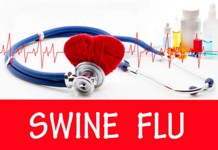 swine flu vaccination: The diagnosis of swine flu. Phonendoscope and vaccine with drugs. Medical concept.