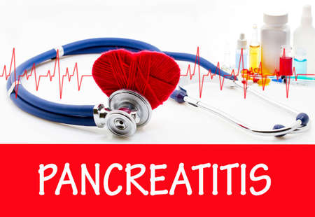 pancreatitis: The diagnosis of pancreatitis. Phonendoscope and vaccine with drugs. Medical concept.