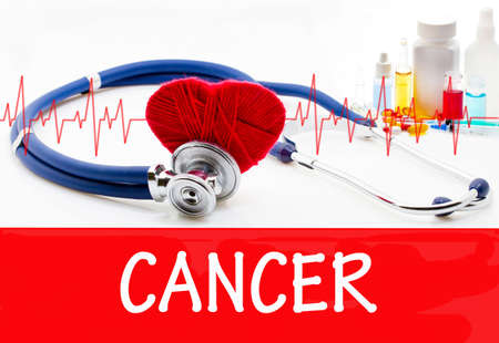 cancer drugs: The diagnosis of cancer. Phonendoscope and vaccine with drugs. Medical concept.