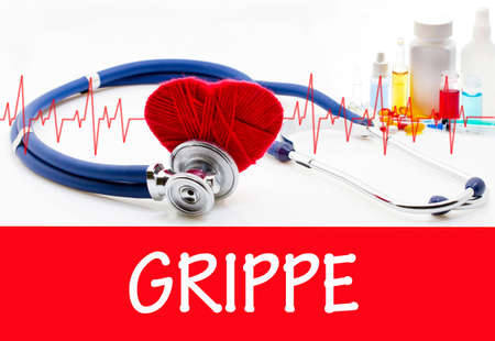 grippe: The diagnosis of grippe. Phonendoscope and vaccine with drugs. Medical concept.