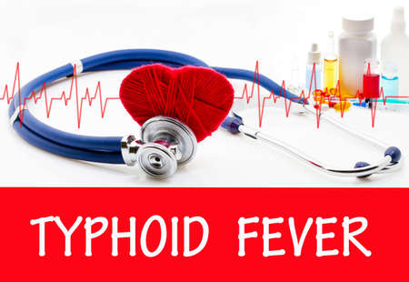 typhus: The diagnosis of typhoid fever. Phonendoscope and vaccine with drugs. Medical concept. Stock Photo