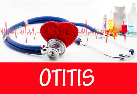 eardrum: The diagnosis of otitis. Phonendoscope and vaccine with drugs. Medical concept. Stock Photo