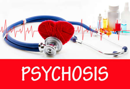 psychosis: The diagnosis of psychosis. Phonendoscope and vaccine with drugs. Medical concept. Stock Photo