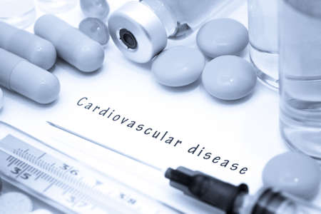inflamation: Cardiovascular disease - diagnosis written on a white piece of paper. Syringe and vaccine with drugs. Stock Photo