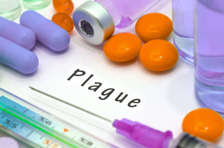 pandemic: Plague - diagnosis written on a white piece of paper. Syringe and vaccine with drugs.