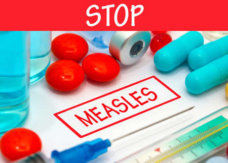 measles: Stop measles. Vaccine to treat disease. Syringe and vaccine with drugs.