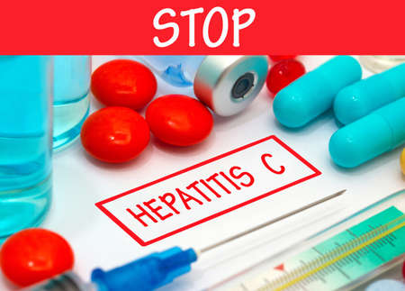polymerase: Stop hepatitis c. Vaccine to treat disease. Syringe and vaccine with drugs.
