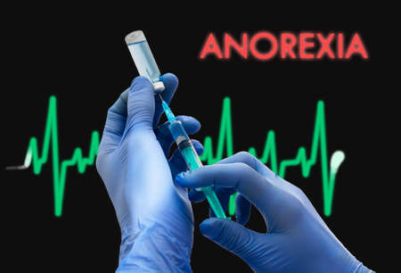 anorexia: Treatment of anorexia. Syringe is filled with injection. Syringe and vaccine. Medical concept. Stock Photo