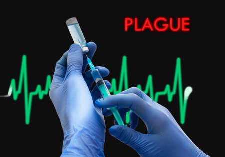 plague: Treatment of plague. Syringe is filled with injection. Syringe and vaccine. Medical concept.