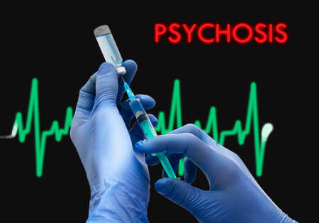 psychosis: Treatment of psychosis. Syringe is filled with injection. Syringe and vaccine. Medical concept.