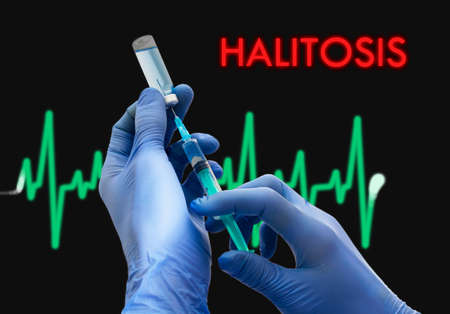 halitosis: Treatment of halitosis. Syringe is filled with injection. Syringe and vaccine. Medical concept.