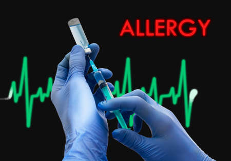 hypersensitivity: Treatment of allergy. Syringe is filled with injection. Syringe and vaccine. Medical concept. Stock Photo