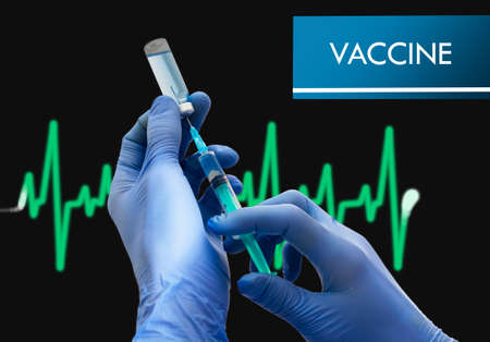 immunize: Vaccine. Syringe is filled with injection. Syringe and vaccine. Medical concept.