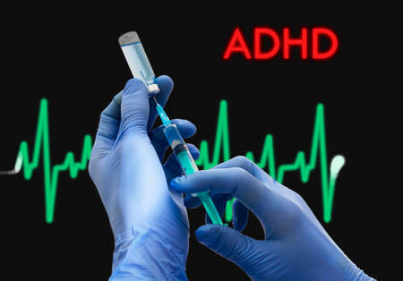 inattention: Treatment of ADHD (attention deficit disorder). Syringe is filled with injection. Syringe and vaccine. Medical concept.