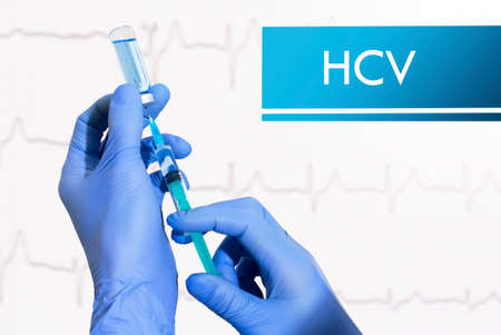 Stop HCV (hepatitis C). Syringe is filled with injection. Syringe and vaccine Stock fotó