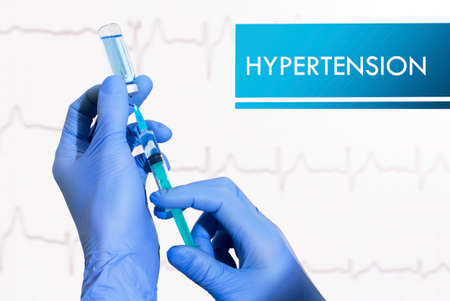 htn: Stop hypertension. Syringe is filled with injection. Syringe and vaccine