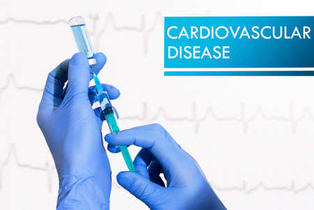 inflamation: Stop cardiovascular disease. Syringe is filled with injection. Syringe and vaccine Stock Photo