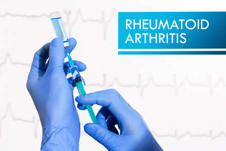 deformity: Stop rheumatoid arthritis. Syringe is filled with injection. Syringe and vaccine