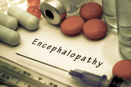 encephalopathy: Encephalopathy - diagnosis written on a white piece of paper. Syringe and vaccine with drugs. Stock Photo