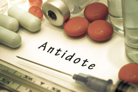 antidote: Antidote - diagnosis written on a white piece of paper. Syringe and vaccine with drugs.